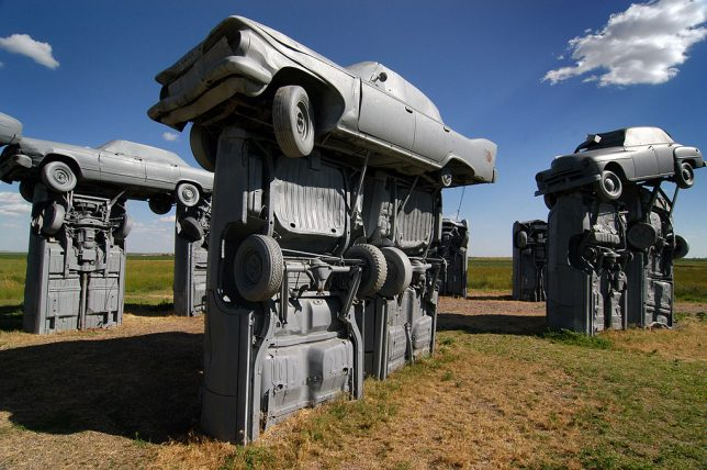 Painting the cars grey at Carhenge makes for a very different look that the colorful graffiti of an attraction like the Cadillac Ranch.