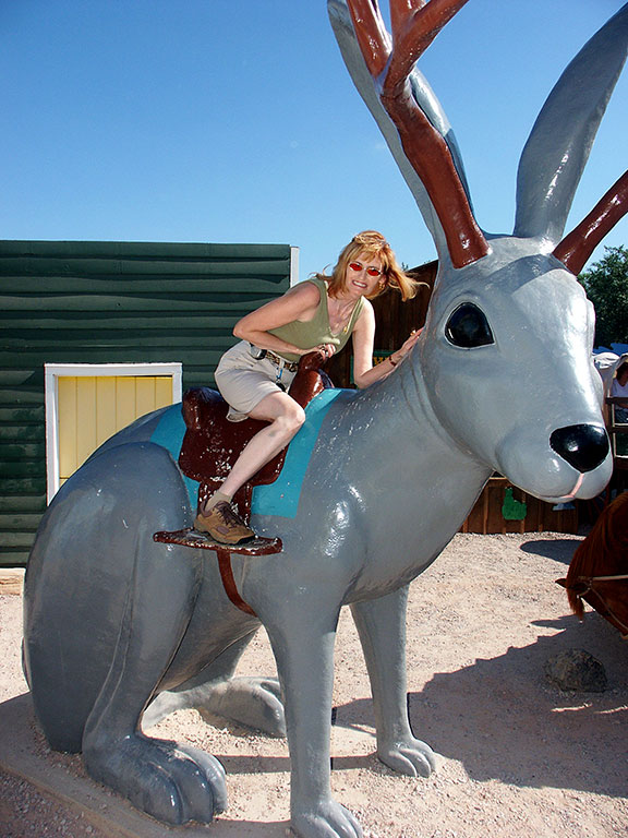 Abby rides the giant Jackalope at Wall Drug.
