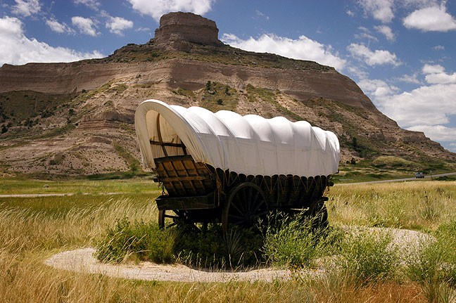 A covered wagon is commemorated at Scotts Bluff National Monument.