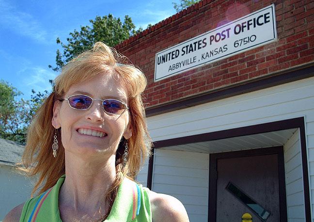 Abby smiles as she posed in Abbyville, Kansas.
