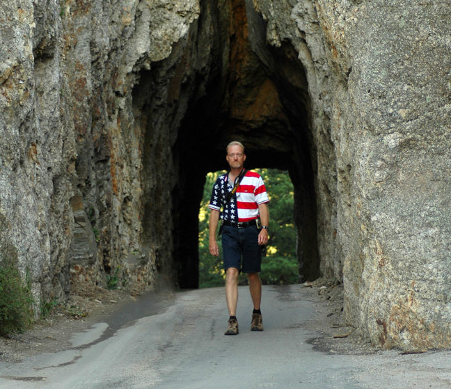 "The author walks through ""The Keyhole,"" a tunnel on the Needles Highway in Custer State Park, South Dakota."
