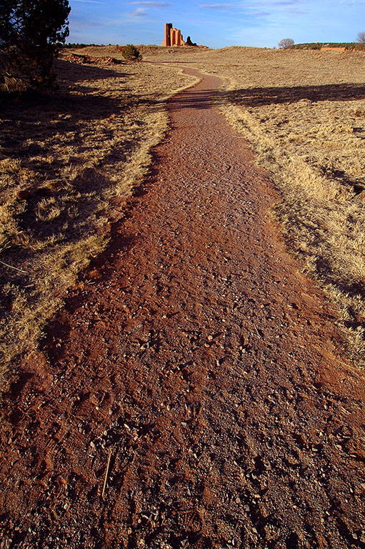 A lightly paved trail leads to the main structures of the Abó Ruin.