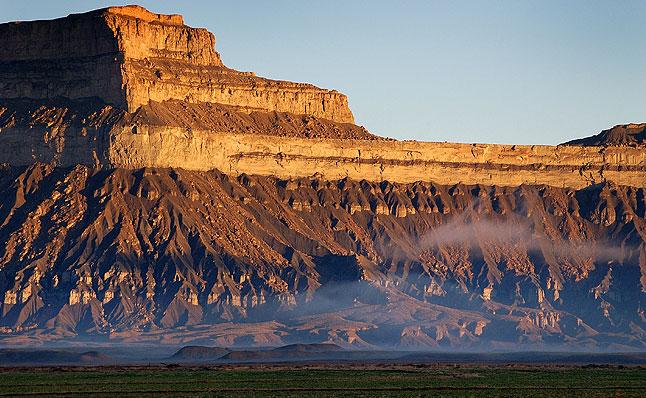 Sunrise and fog, Book Cliffs near Green River, Utah