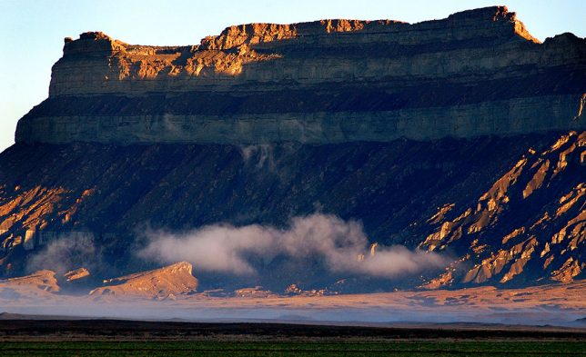 Early light and fog tags the Book Cliffs near Green River, Utah.