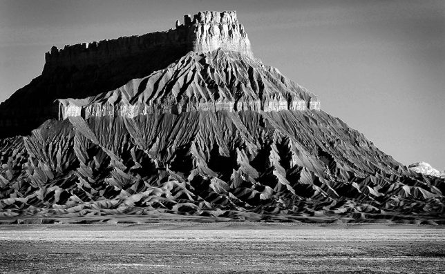 Factory Butte shines in welcome morning sunshine on my way to Capital Reef.