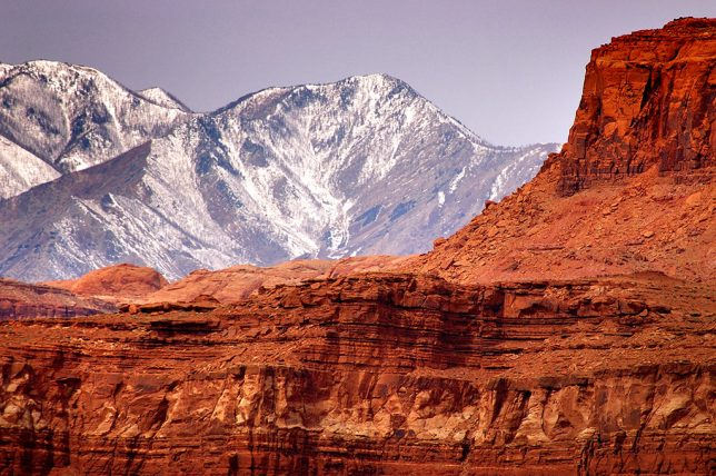 This image, made near Hite Crossing, shows sandstone cliffs set against the Henry Mountains.