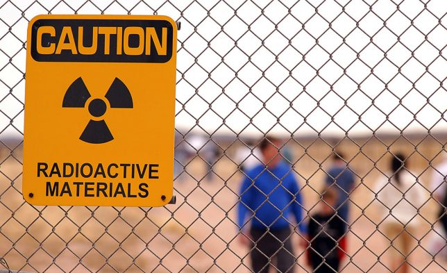 A warning sign hangs on a fence at the Trinity site. There is no danger of occasionally visiting the site, but one presumes increased exposure to ionizing radiation with repeated visits. Many of the dangerous isotopes, however, have long since decayed into stable materials.