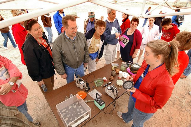 The twice annual Trinity site schedule becomes a cottage industry of its own, featuring kiosks where people sell Trinitite, take Geiger counter readers, and compare radiation levels of household items to the background radiation at the site. It's quite a show.