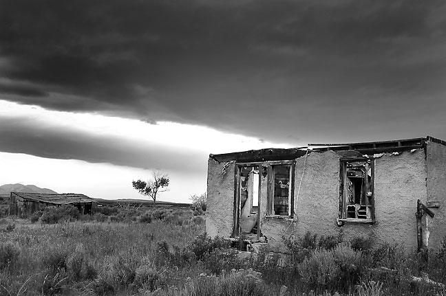 Abandoned house and clouds near Yellow Jacket, Colorado.