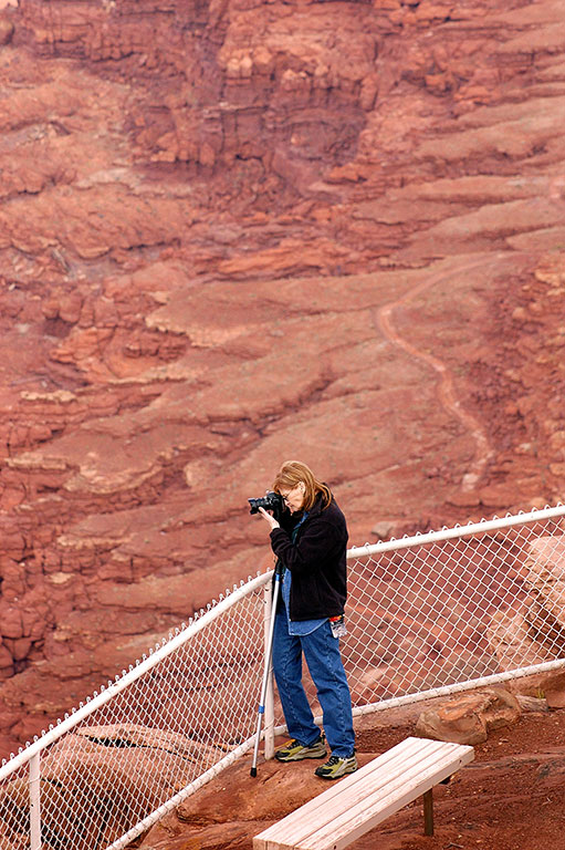 Abby is dwarfed by the scenery as she photographs the Anticline Overlook.