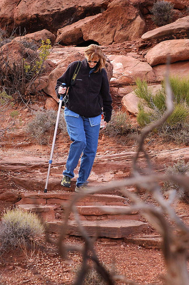 Abby uses her hiking pole as she walks around at the Anticline Overlook
