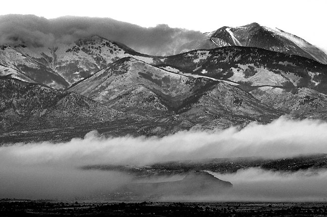 Clouds and blowing snow create this haunting view of the La Sal Mountains.