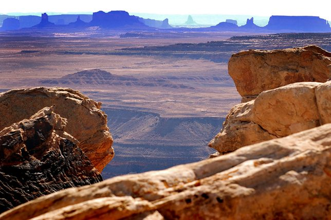 Some of the features of Monument Valley are visible in this telephoto image looking south from Muley Point, Utah.