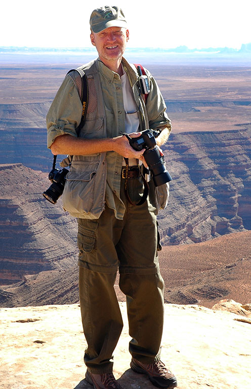 I smile for Abby's camera as we photograph Muley Point. The meanders of the San Juan River are behind me.