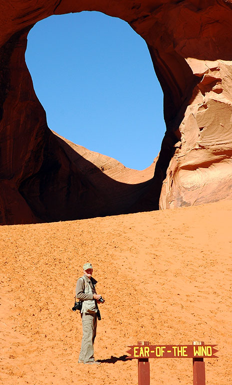 Abby photographed me photographing the Ear of the Wind natural arch.