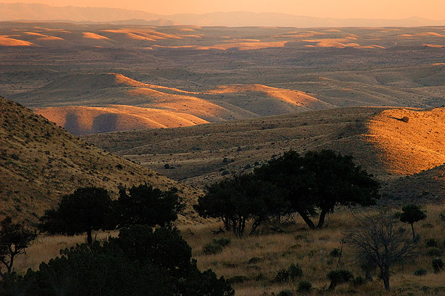 The rolling hills and prairies of west Texas come into view in this image made at last light from the Devil's Hall trail.