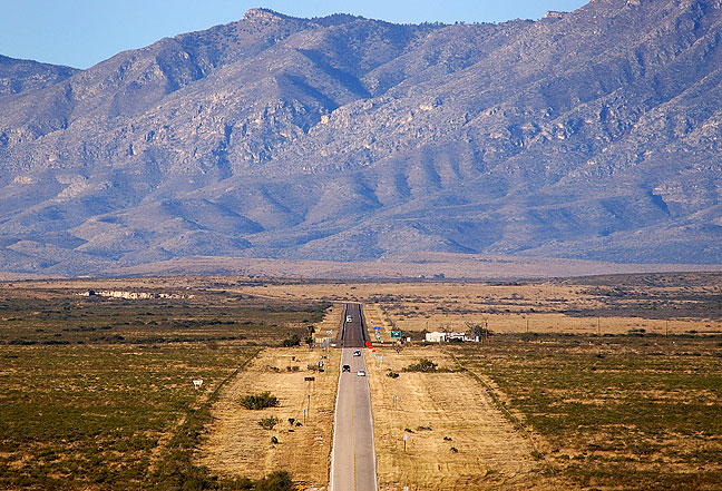 This view looks south from New Mexico and shows the border signs on highway 180, with the Guadalupe Mountains in the distance.