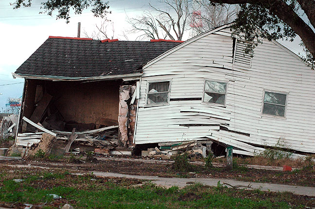"When we visited, Nicole took us on a ""destruction tour."" Many houses, like this one not far from Nicole's, were damaged beyond repair."