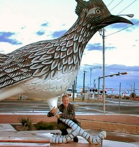 Your host poses with Paisano Pete, a huge roadrunner statue, in Fort Stockton, Texas.