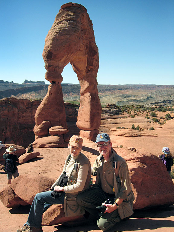 Abby and I smile as we pose near Delicate Arch where our marriage began three years earlier.