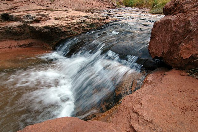 Water flows in Negro Bill Canyon. This canyon trail leads to Morning Glory Natural Bridge.