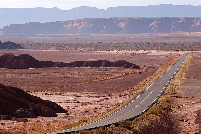 Red earth badlands and U. S. 191, northern Arizona.