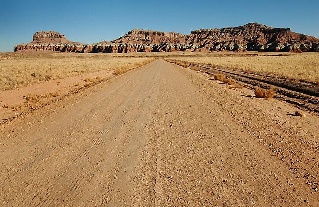 Unpaved road and Wild Horse Mesa, San Rafael Swell, Utah.