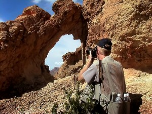 Photographing an unnamed conglomerate natural arch in The Chimneys section of Big Bend