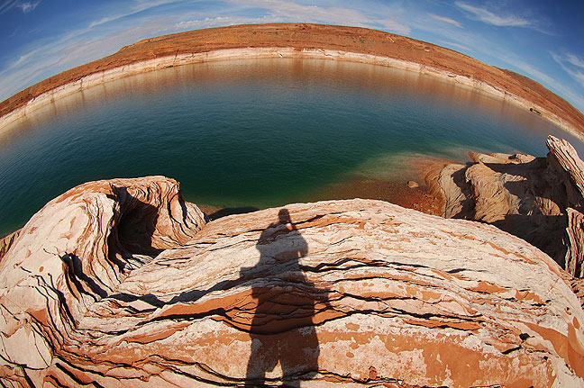 Self portrait on a sandstone beach at Lake Powell.