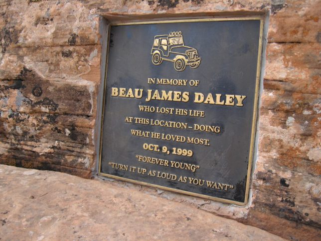 A bronze plaque is embedded in the rock at Gemini Bridges, where Beau James Daley died Jeeping there in 1999.