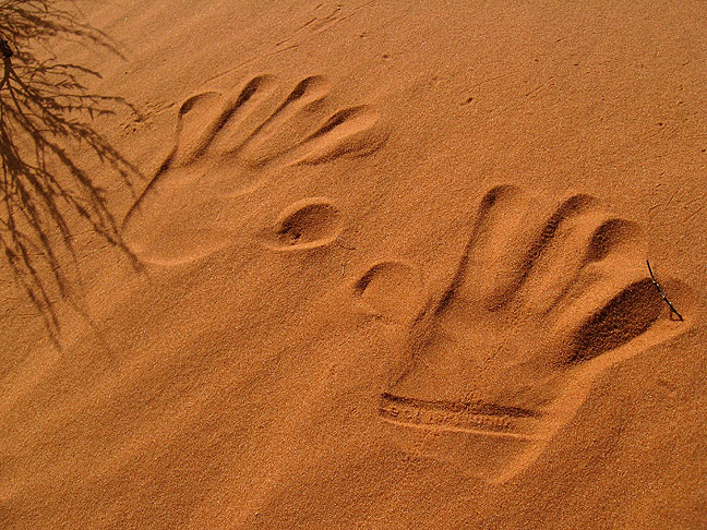 Hand prints are visible in a sand dune at Klondike Bluffs.