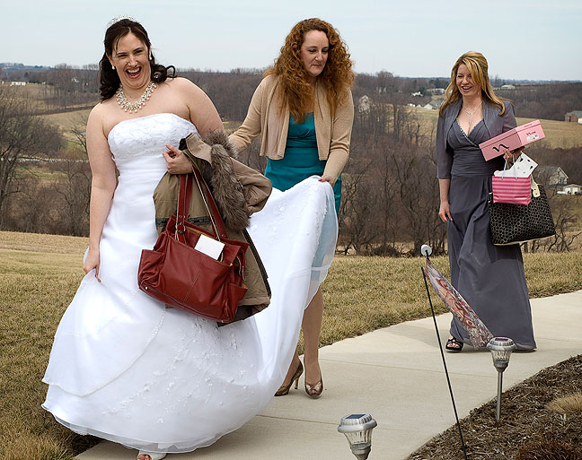 Richard's sister Nicole hold's Chele's veil, with Kim bringing up the rear, as Chele walks to her waiting limousine.