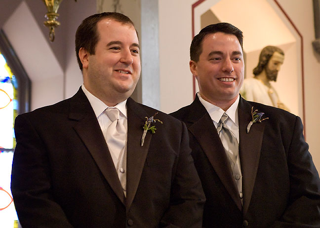 Tom Reeves and his best man John watch as Chele walks down the aisle.