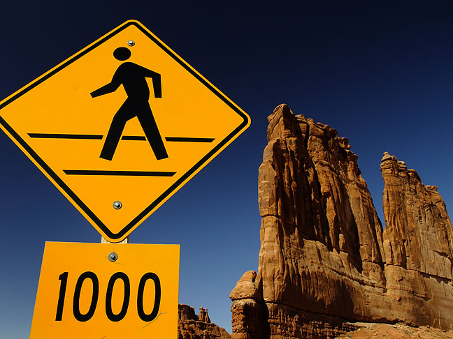 Traffic sign and Courthouse Towers, Arches National Park, Utah. 