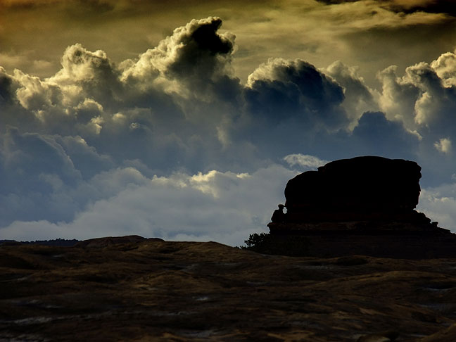 Gloomy cumulous clouds in the Needles district at Canyonlands.