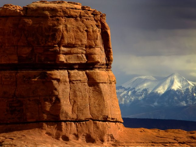 The formations of Canyonlands are set against the La Sal Mountains.