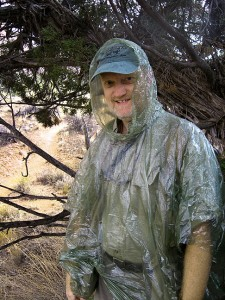 In my emergency poncho under a tree, hiding from small hail