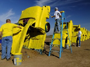 LiveStong volunteers paint Stanley Marsh's Cadillac Ranch
