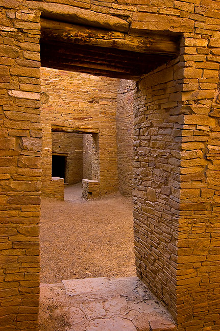 This view through a doorway shows a t-shaped entrance to a small room. The room inside was vandalized in 2004, and had to be completely restored by the park service.