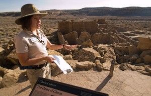 "SCA ranger Lauren Blacik at the top of ""Threatening Rock,"" the 30,000-ton boulder that collapsed on Pueblo Bonito in 1941"