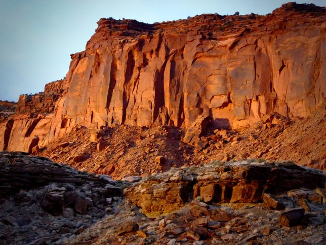 Sunset light gathers on the Wingate Sandstone of Hatch Point above Indian Creek. This feature is on the route to The Needles District at Canyonlands National Park, Utah.