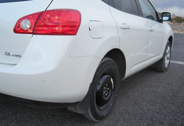This is the temporary spare on my Nissan Rogue, placed there after a crew came from Monticello to chisel off the locking lug nut on the regular wheel, the key for which was misplaced by my tire shop.