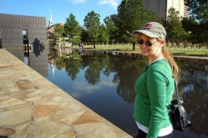 Abby walks along the reflecting pool at the Oklahoma City National Memorial.