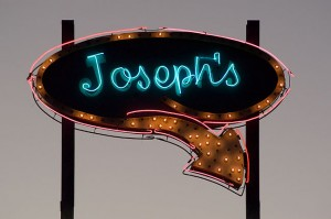Restaurant sign, Vaughn, New Mexico, at dusk. My father's name was Joseph.