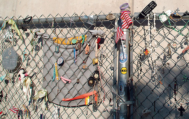 """The Fence"" is a relic from the period immediately after the bombing, where people left memoirs prior to the creation of the memorial, and to this day. Abby was moved by the entire memorial, but when she got to the fence, she was unable to hold back her tears (Photo by Abby S. M. Barron)."
