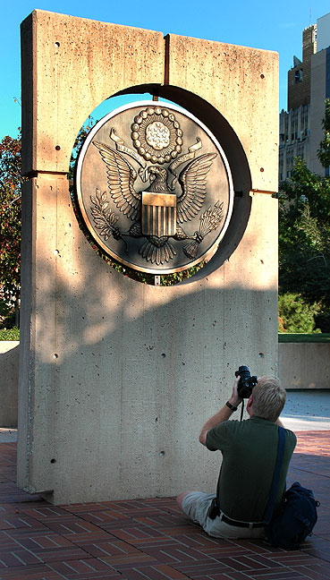 Richard photographs a bronze medallion on the Murrah Building foundation (Photo by Abby S. M. Barron).