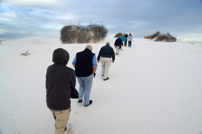 Our natural walk group makes its way up a white sand mound. The light at that moment was flat, but only a few minutes later, the clouds parted, giving a beautiful performance at sunset.