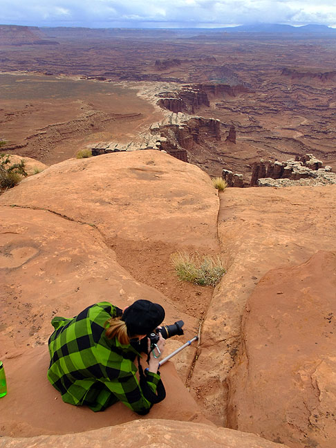 Abby photographs the view on the White Rim Overlook trail.