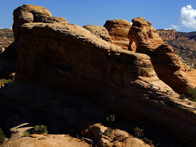 This tighter view from above the trail makes it easier to see Delicate Arch.