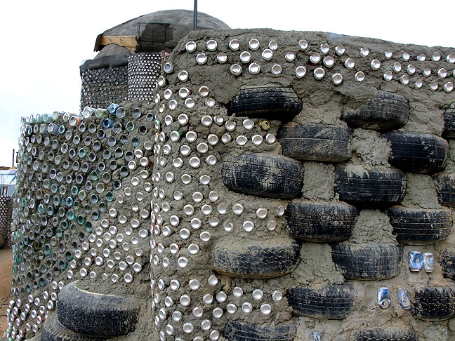 Tires and aluminum cans also figure in the Earthship design, which emphasizes recycling.